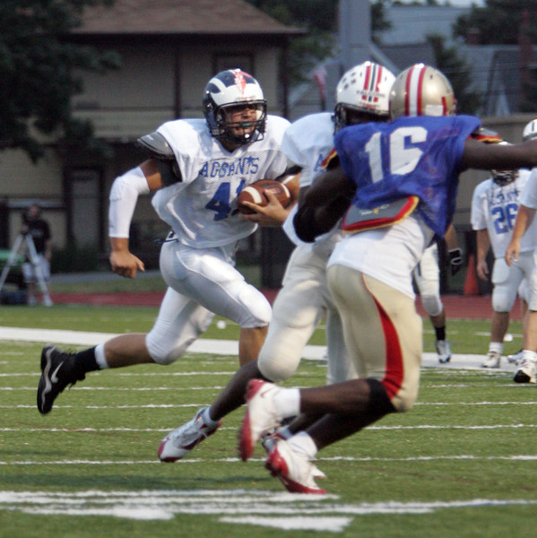 Kyle Shonio of Swampscott carries teh ball at the Agganis All Star football classic at Manning Field Thursday July 15, 2010. Item Photo/ Reba M. Saldanha