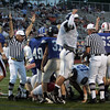 The ref calls a TD for the South side during the Agganis All Star football classic at Manning Field Thursday July 15, 2010. Item Photo/ Reba M. Saldanha