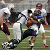Classical's Chevere Archer takes down David St Pierre of North Shore during the Agganis All Star football classic at Manning Field Thursday July 15, 2010. Item Photo/ Reba M. Saldanha