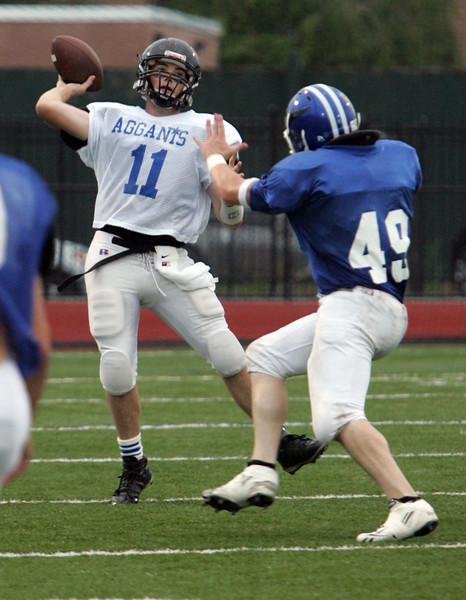 Hayes Richardson of Marblehead and Chris Esposito of Georgetown during the Agganis All Star football classic at Manning Field Thursday July 15, 2010. Item Photo/ Reba M. Saldanha
