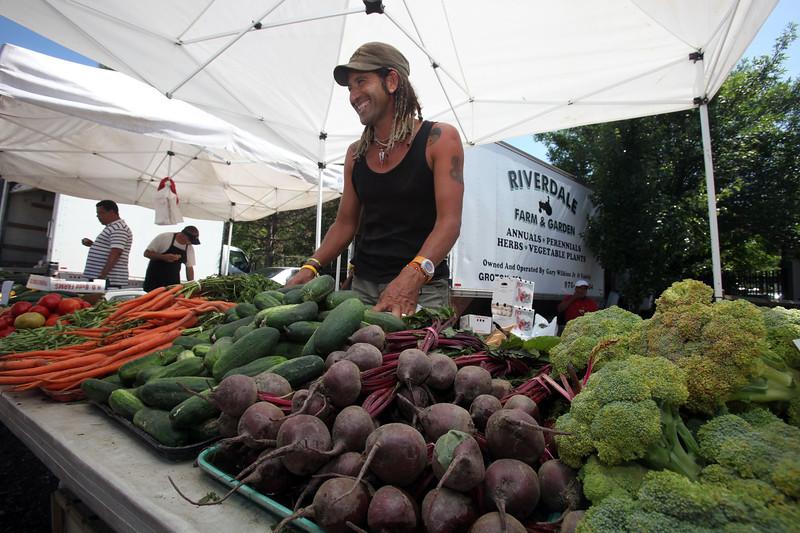 Canneri Moquetiet sells vegetables for Riverdale Farm of Groton at Lynn's Central Square farmer's market Thursday July 15, 2010. Item Photo/ Reba M. Saldanha