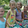 Cousins (from left) Kaylee and Amber James and Jamie and Shea Kedney make sa bracelet during the Friends of Lynn Woods family fun day  Saturday July 17, 2010. Item Photo/ reba M. Saldanha