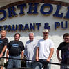 Porthole pub proprietor Bob Gaudet, center, joins My Home Town actors Ryan Merriman and Casey Margolis and directors, Peabody natives Joel and Johnny Wowk for a photo before filming sceenes inside the pub Saturday July 17, 2010. Item Photo/ reba M. Saldanha