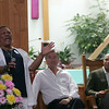 John Tierney and Deval Patrick listen to Gospel singer Doreen Murray at Zion Baptist Church Sunday July 18, 2010. Item Photo/ Reba M. Saldanha