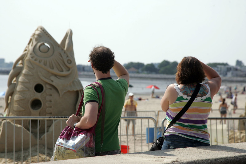 Onlookers take in the sights at Revere Beach's annual sand sculpture competition Saturday July 17, 2010. Item Photo/ reba M. Saldanha