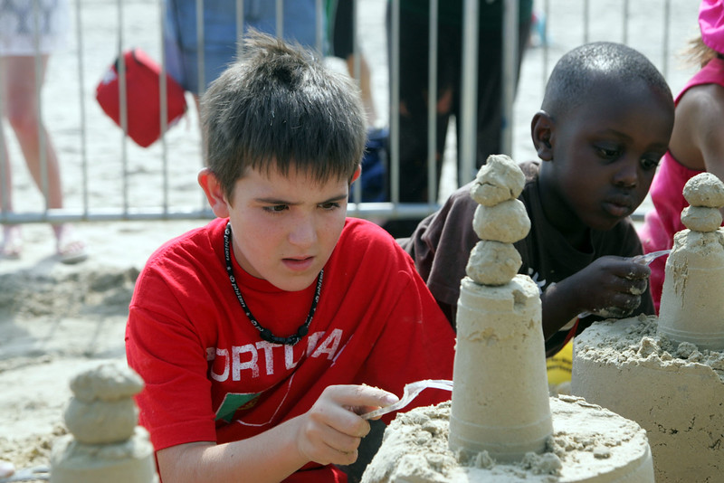 Amiyr Ahmad, 5 from WAtertown, right, and Mason White of Middleton  learn how to build a sand castle at Revere Beach's annual sand sculpture competition Saturday July 17, 2010. Item Photo/ reba M. Saldanha