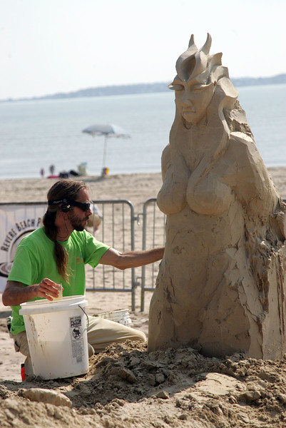 Carl Jara's works on 'Convergence'at Revere Beach's annual sand sculpture competition Saturday July 17, 2010. Item Photo/ reba M. Saldanha