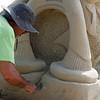 Sculptor Matt Martelli works at Revere Beach's annual sand sculpture competition Saturday July 17, 2010. Item Photo/ reba M. Saldanha