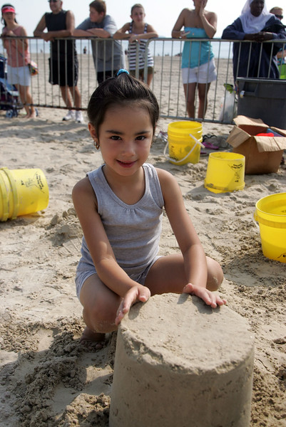 Mykaela Garay learns how to make a sandcastle at Revere Beach's annual sand sculpture competition Saturday July 17, 2010. Item Photo/ reba M. Saldanha