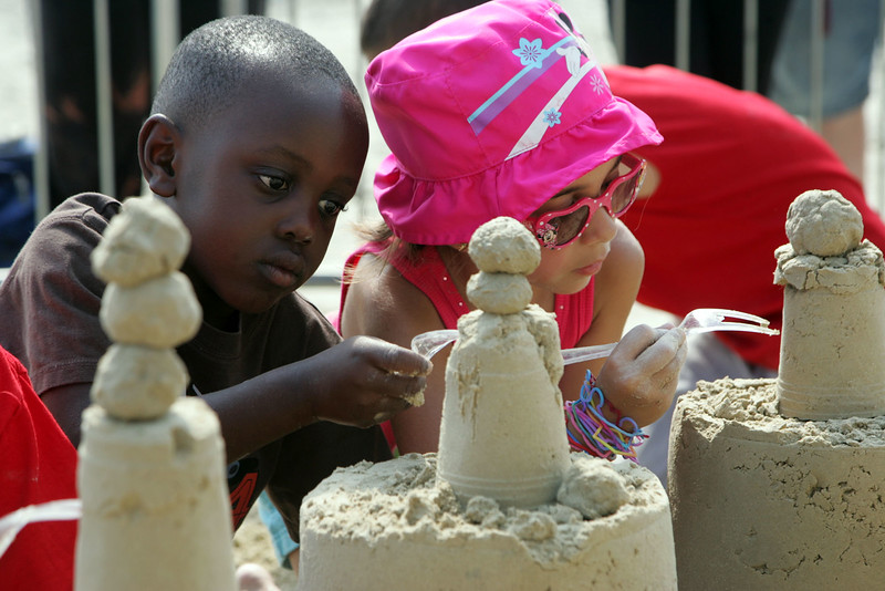 Amiyr Ahmad, 5 from WAtertown, and Gianna Korisianos, 5 of Revere, learn how to build a sand castle at Revere Beach's annual sand sculpture competition Saturday July 17, 2010. Item Photo/ reba M. Saldanha