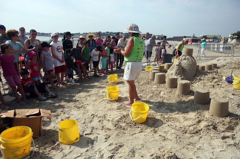 Sandi Stirling instructs children at Revere Beach's annual sand sculpture competition Saturday July 17, 2010. Item Photo/ reba M. Saldanha