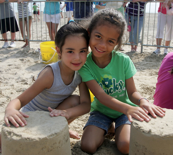 Mykaela Garay and cousin Kaillen Bosquet  learn how to make a sandcastle at Revere Beach's annual sand sculpture competition Saturday July 17, 2010. Item Photo/ reba M. Saldanha