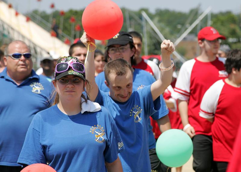 Athelete Donnie Davis raises his balloon during hte opening parade at the Agganis Special Olympics at Saugus High Shcool Saturday July 17, 2010. Item Photo/ reba M. Saldanha