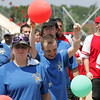 Athelete Donnie Davis raises his balloon during hte opening parade at the Agganis Special Olympics at Saugus High Shcool Saturday July 17, 2010. Item Photo/ reba M. Saldanha