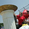 Susan Shepardson of Lynn lights the olypmic torch at the Agganis Special Olympics at Saugus High Shcool Saturday July 17, 2010. Item Photo/ reba M. Saldanha