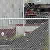 Fire fighters douse a GE building Monday July 19, 2010. Item Photo/ Reba M. Saldanha