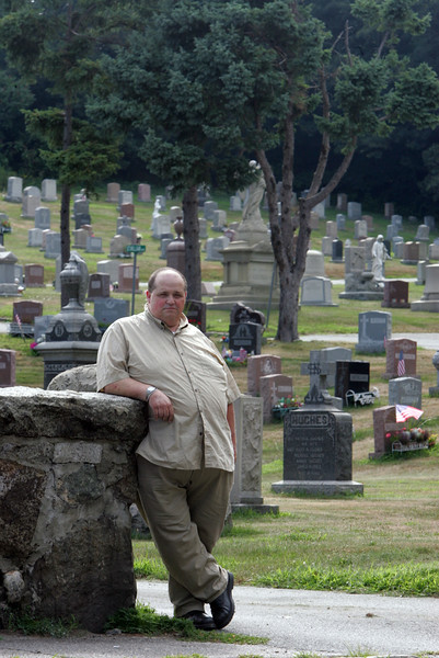 Charles Bugden, Grand Knight at Knights of Columbus on Lynnfield St, poses at St Mary's Cemetary Tuesday July 20. 2010. Item Photo/ Reba M. Saldanha