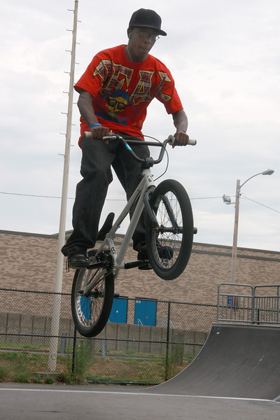 Richie Cooper jumping at the skate board park behind Lynn Technical Institute today.