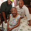 Three generations: Ana Henriquez, 105 years old, Maria Garcia, granddaughter, and Julio Sanabia, great grandson.