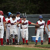 Teammates anticipate Jack Fitzpatrick at home plate after his home run  in Beverly Thursday July 22, 2010. Item Photo/ Reba M. Saldanha