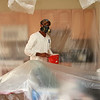 Andre Almeida, of Arch Paining Inc. of Peabody, with mask and plastic covering in a house in Salem.