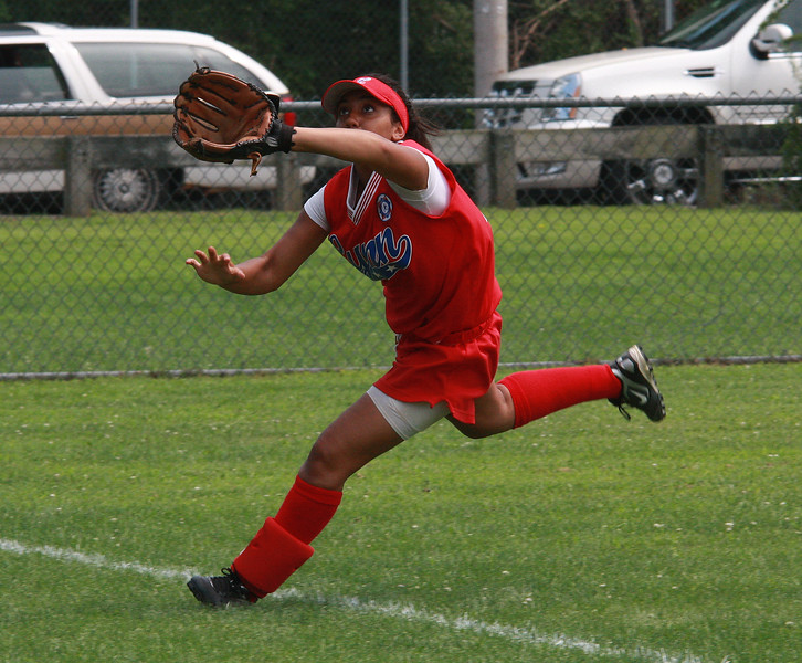 Thaliann Cuevos focuses on one in left field.