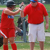 Gaby Trahant gets the high five from coach Joe McGovern after she beat the throw to first.
