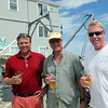 Sailors (from left) Ed Barker, Dave Genovese, and Joel White at the conclusion of Boston Yatch Club's race week in Marblehead Sunday July 25, 2010. Item Photo/ Reba M. Saldanha
