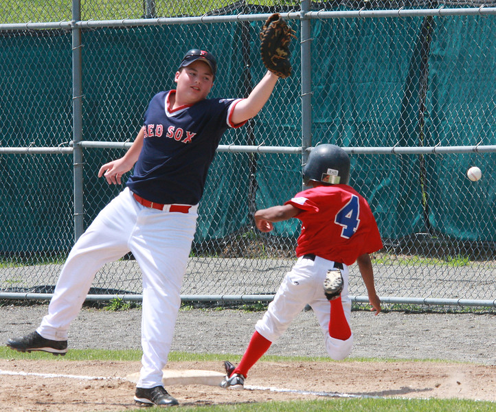Mike Melanson gets a wide throw allowing Amri Gaston to land of first safely. City Series on Saturday.