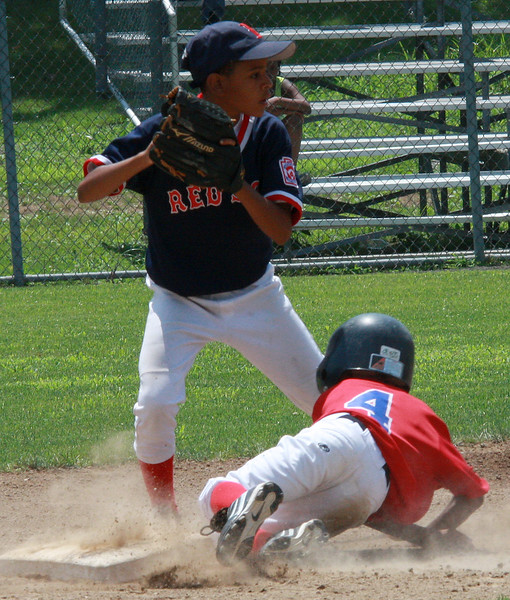 Ricardo Bratini, standing, making the play on Amri Gaston at second. City Series on Saturday.