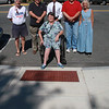 The Saugus sidewalk committee in front of one of the handicapped accessible sidewalks. Standing from left to right: Henry Marrifield, Peter Manoogan, Andrew Bisignani, Ray Laurence, and Jeanie Bartolo. Sitting is Kathy Forbes.