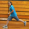 Drew Nelson runs to second base during a game of bounce pitch at the summer gym program at Saugus High today.