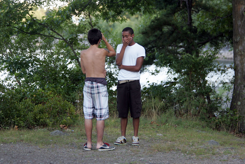 Witnesses react to the drowning death of 16 year old Salim Fort near Breed's Pond in Lynn Tuesday 27, 2010. Item Photo/ Reba M. Saldanha