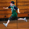 Joe Gilmartin runs to third during a game of bounce pitch in the gym at Saugus High.