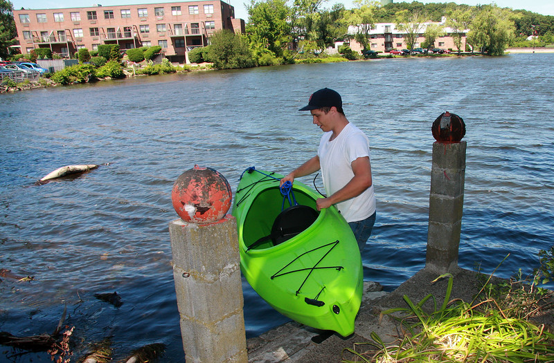Patrick Coppola spends one hour a day in his Kayak search Floating Bridge Pond searching for junk.