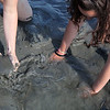 Lindsey Greene, left, and Cassi Couillard dig for clams on Lynn Beach Tuesday July 27, 2010. Item Photo/ Reba M. Saldanha