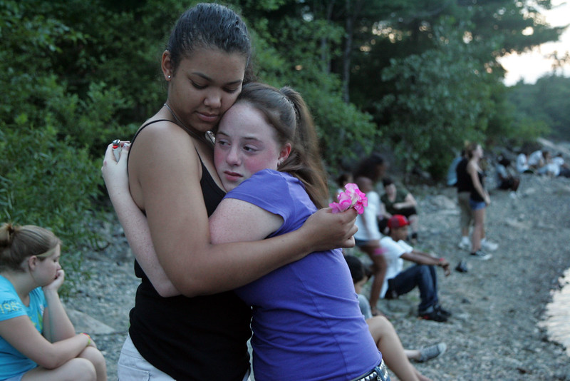 Mourners Melissa Basanisi, right,a nd Crystal Rosario during a memorial for drowning victim Salim Fort near where he drowned Tuesday in Breed's Pond Wednesday July 28, 2010. Item Photo/ Reba M. Saldanha