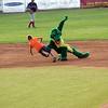 Mascot Chompers trips up Josh while base running between innings at the North Shore Navigators game Wednesday July 28, 2010. Item Photo/ Reba M. Saldanha