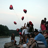 Mourners release balloons during a memorial for drowning victim Salim Fort near where he drowned Tuesday in Breed's Pond Wednesday July 28, 2010. Item Photo/ Reba M. Saldanha