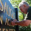 Carmine Moshchella, a retired vice principal and one of the board members at the Senior Center, spends some of his spare time making sure the sign at the Saugus Senior Center looks good.