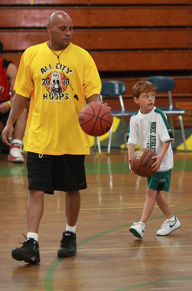Like father, like son. Miles Manalaysay following his dad Flynn Manalaysay during half time at the Lynn All-City basketball game at the Fecteau Leary School