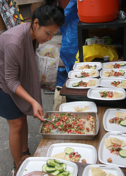 Linda Son preparing food at the Weed-Read-Feed program at the Ford School.