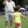 Tim McCoy films daughter Sydney during the Swampscott July 4 races at Phillips Park SundayJuly 4, 2010. Item Photo/ Reba M. Saldanha