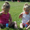 Isabelle Skabeikis, left, and sister Sophie blow bubbles during the Nahant July 4 races at Flash Road playground SundayJuly 4, 2010. Item Photo/ Reba M. Saldanha