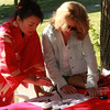 Five workshops were held at the World Folk Festival at Lynn Heritage State Park on Saturday, including this one on Japanese Calligraphy being taught to Elaine Liebowitz by  Michiko Imai: Shihan, a master Japanese Calligrapher.