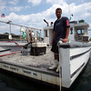 James Moleti, 22, stands on the stern of his lobster boat in Nahant Harbor Tuesday July 6, 2010. Item Photo/ Reba M. Saldanha