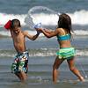Dante Yepez and Ava Tramontozzi cool off on Lynn Beach Tuesday July 6, 2010. Item Photo/ Reba M. Saldanha