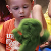 Story time at the Lynn Library began with the kids choosing a puppet. Caleb Csank checks out his frog puppet.
