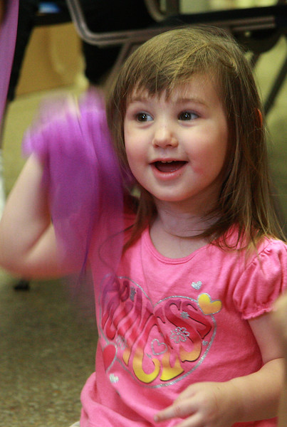 Ema Erwin sings a song during the scarf break during story time at the Lynn Library today.