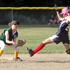 Swampscott's Madeline Dove and WLA's Alycia Bates in the Dist. 16 championship game at Lynn Woods field Wednesday July 7, 2010. Item Photo/ Reba M. Saldanha